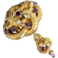 victorian-18k-gold-lovers-knot-purple-chrysoberyl_brooch Beryl Lane - Victorian (1837- 1901)
